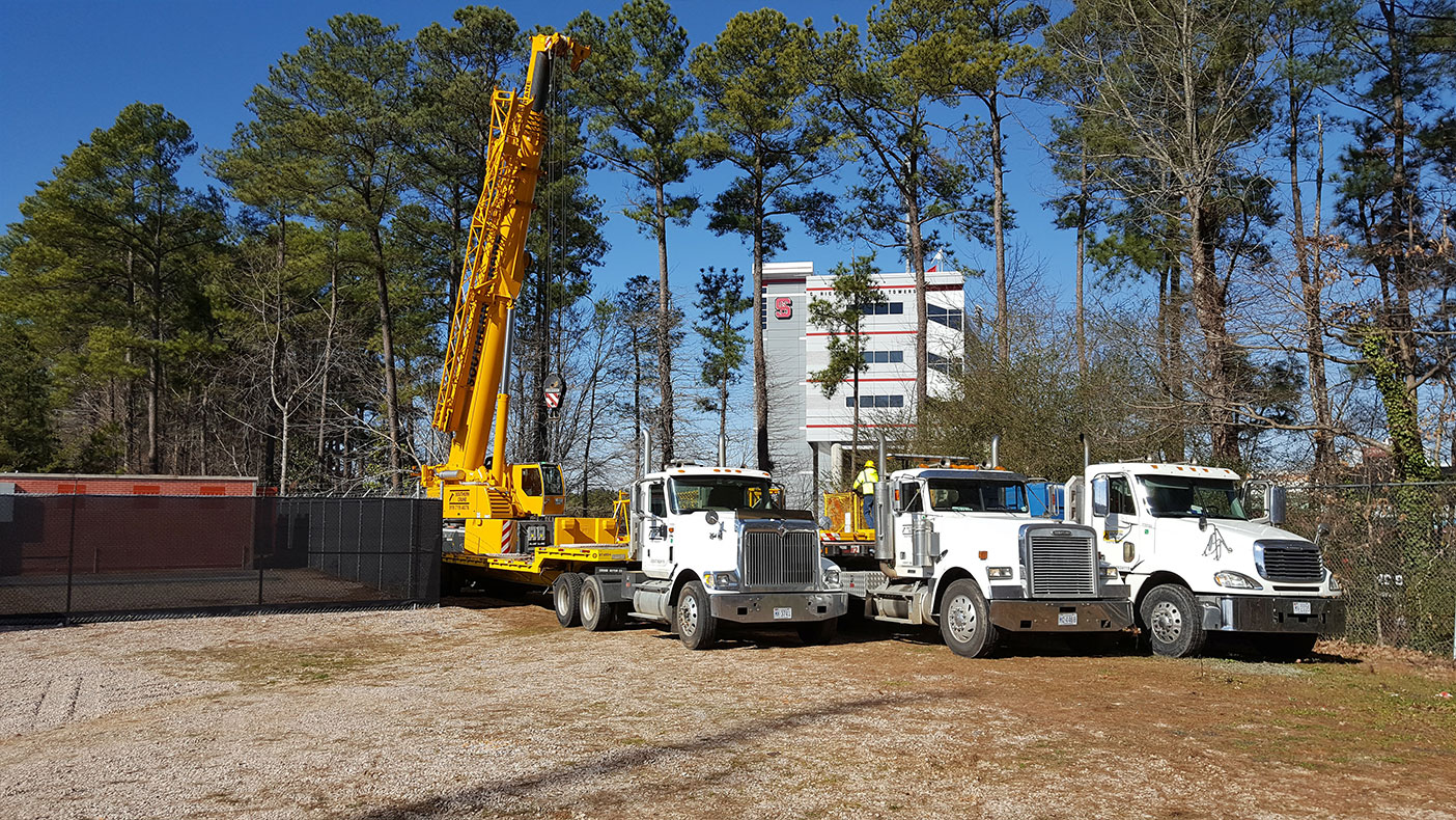 Additional construction services included concrete slab and ground ring installation; and backhaul and power, including trenching and boring.