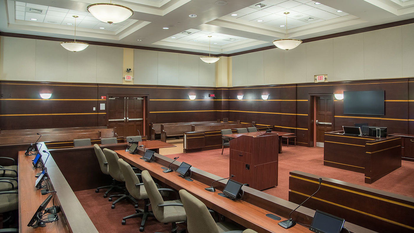 The courtroom now has a more traditional civic image compared to the previous office building where court functions were conducted.