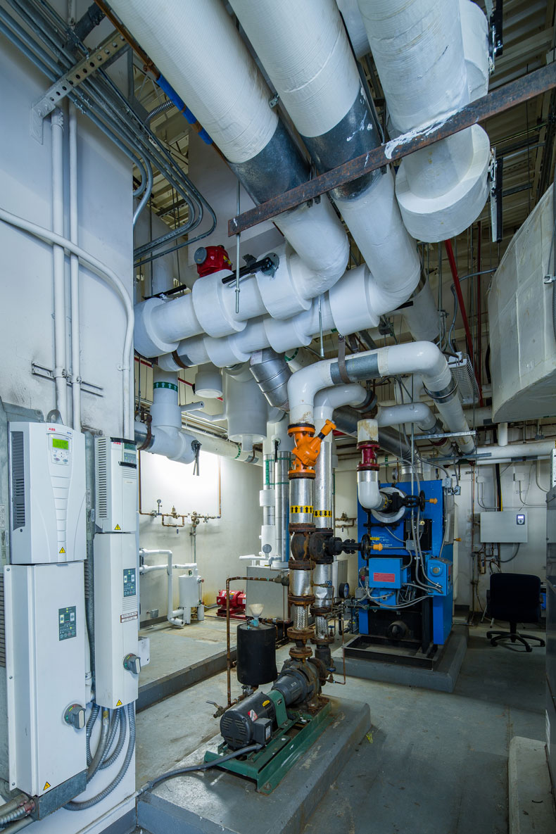 Enhanced part-load performance of the flight simulator's new HVAC system resulted in energy savings estimates of 12 to 18 percent.