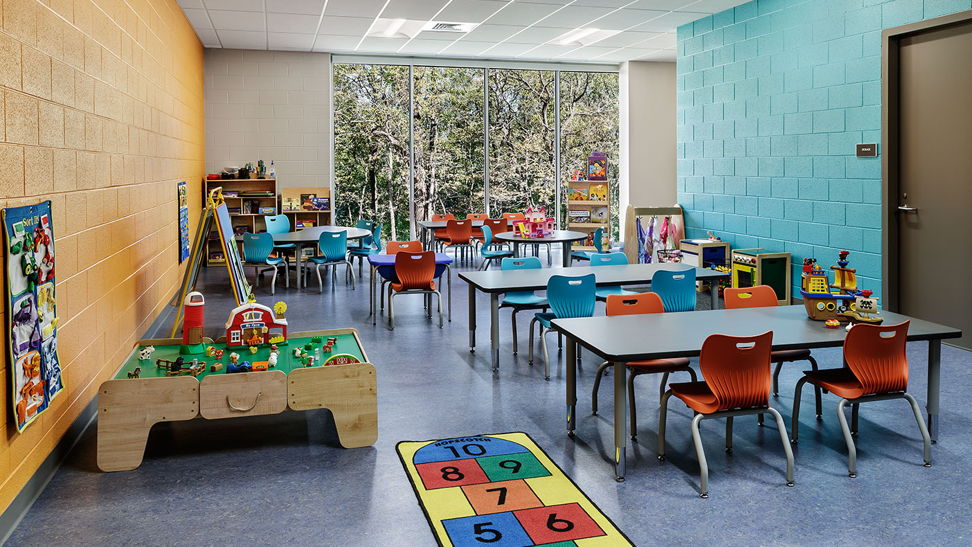 The preschool room includes children's storage cubbies, a storage room, a sink with base and wall cabinets, and restroom.