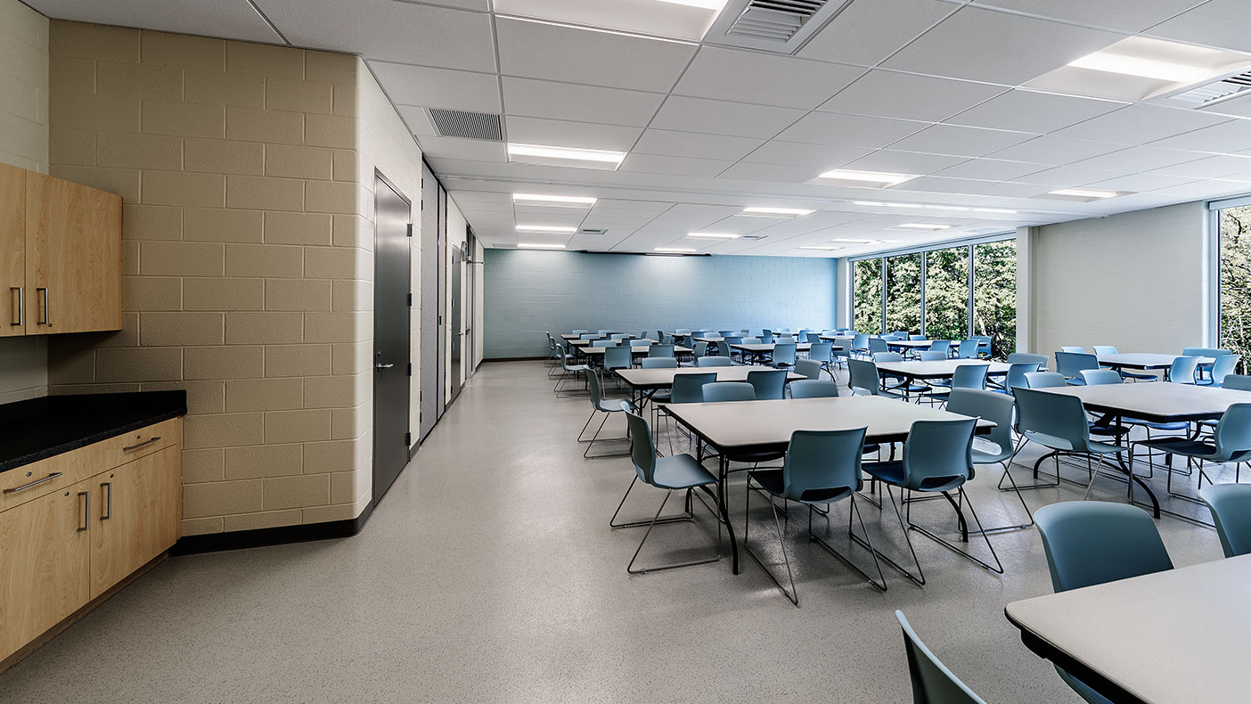 The north facing floor-to-ceiling windows in the fitness center, multipurpose rooms, and preschool room provide a view of Mill Creek and the surrounding park.