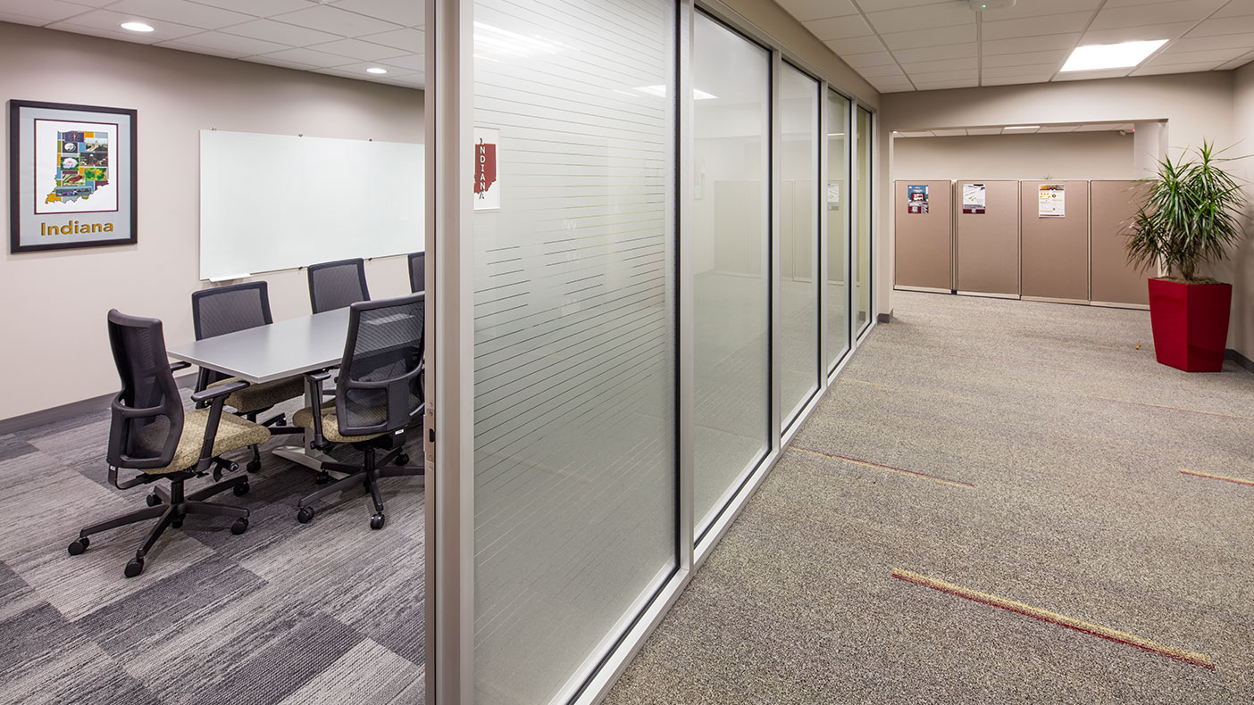 Frosted glass paneled offices and workstations allow perimeter daylighting into the workplace.
