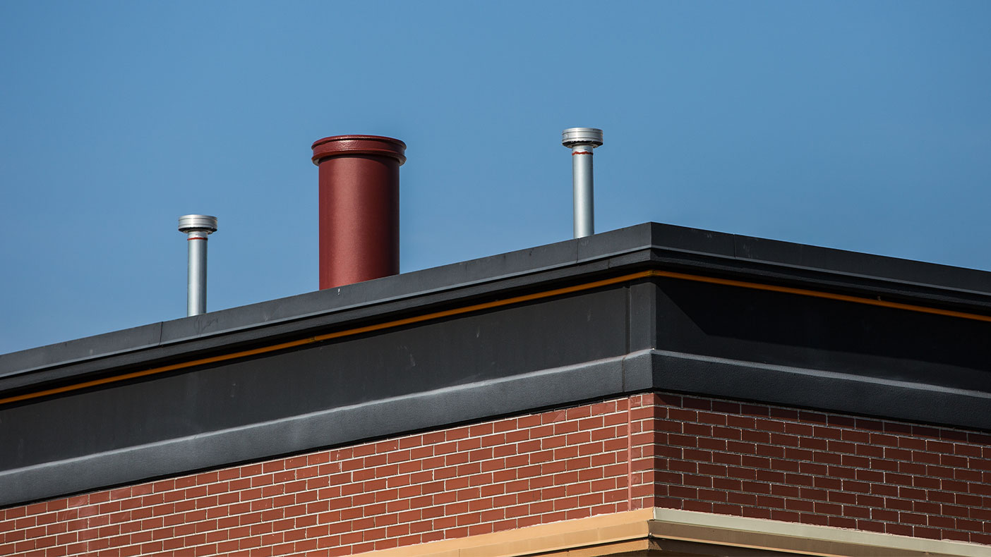 To maintain aesthetics, a stove pipe made of RF transparent material was mounted on the antenna and painted to match the existing building architecture, which also concealed the equipment.