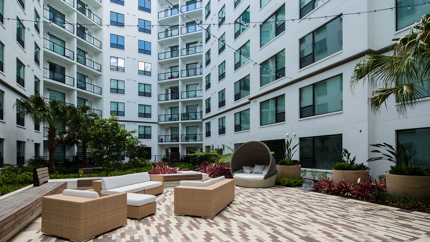 The Sevens includes interior and exterior courtyards, patio, grill, and a dog park.