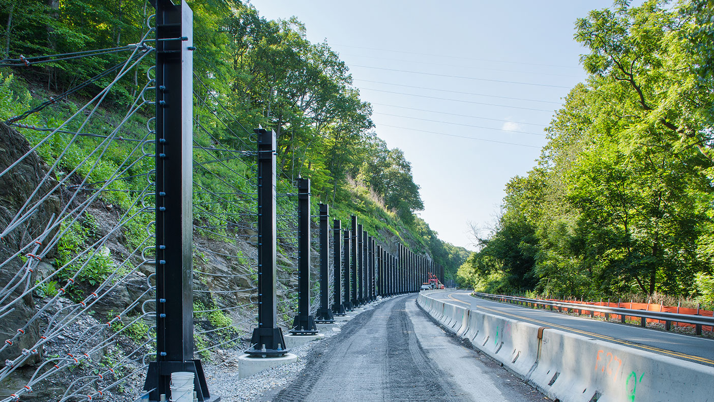 We supplied design specifications, documentation, and cost estimates for the mile long, 4-foot wide rockfall catchment final design.